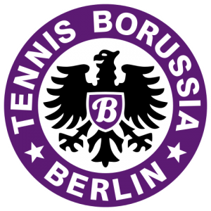 Emblem of the Berlin football team Tennis Borussia which is mainly a bird, perhaps an eagle, on a part purple background.