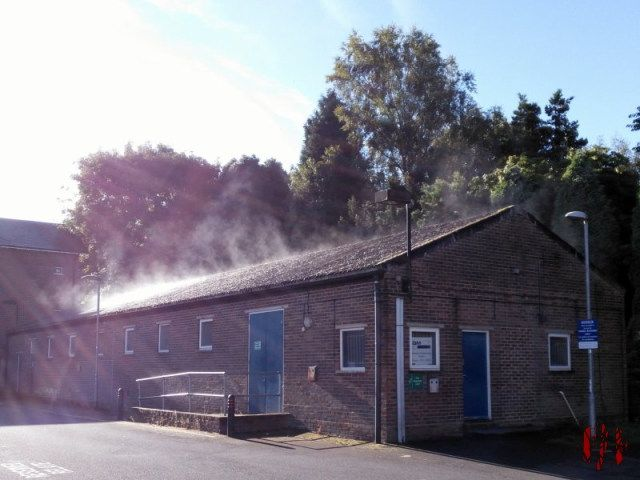 Steam rising off QM Studios behind the Drill Hall Horsham after a shower on a hot day.