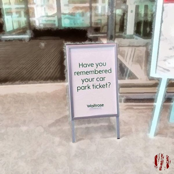 A sign on the way out of Waitrose supermarket asking shoppers if they'd remembered to bring their car park ticket so they can get it scanned and not have to pay for parking.