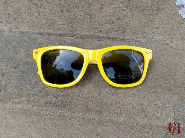 Cheap yellow rimmed sun glasses with your truly reflected in the lenses.