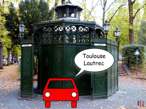 "A cartoon car in front of an old Berlin public toilet saying, ""Toulouse Lautrec""."