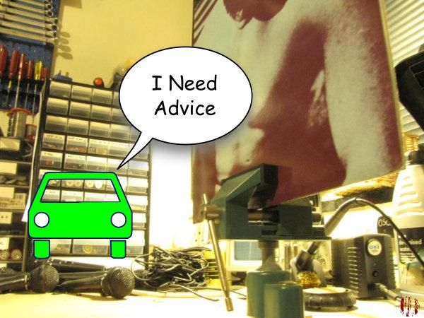 "A cartoon car says, ""I need advice"" whilst a copy of The Smiths first LP is in the foreground in a vice."