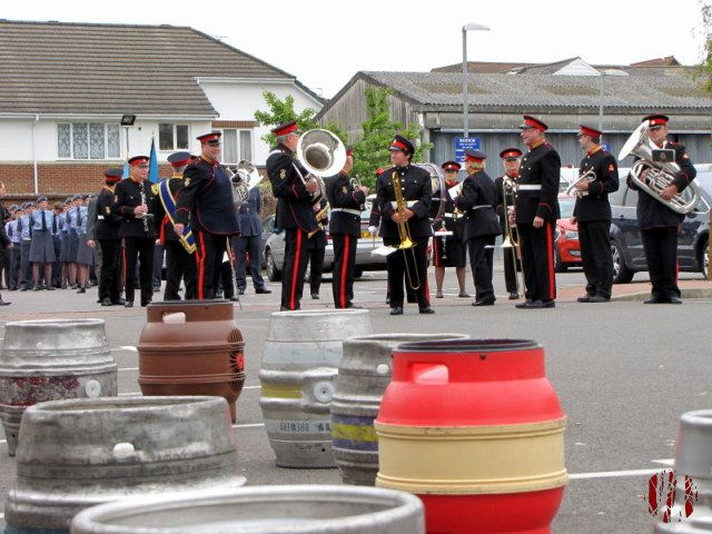 The Band Of The British Legion prepare to march to Horsham town centre for a Battle Of Britain Day event with air cadets lined up behind. They are seen across empty barrels from that weekend's beer festival at the Drill Hall.