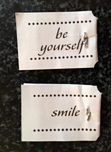 Encouraging advice on some tea bags bought by Tanya Donelly suggesting you should be yourself, and separately, smile.