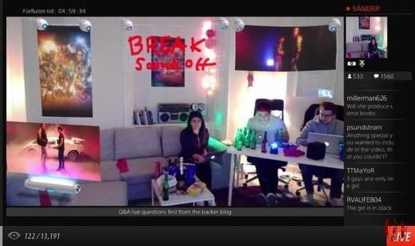 Screen shot of the Kung Fury live stream in the living room of a house with couch to one side and table with laptop computers on to the other with very little going on.