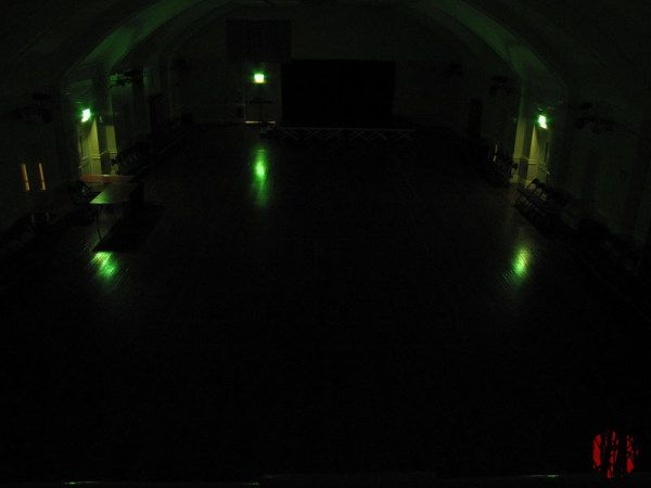 One of a series of photographs taken around the Drill Hall only illuminated by the green fire exit signs.